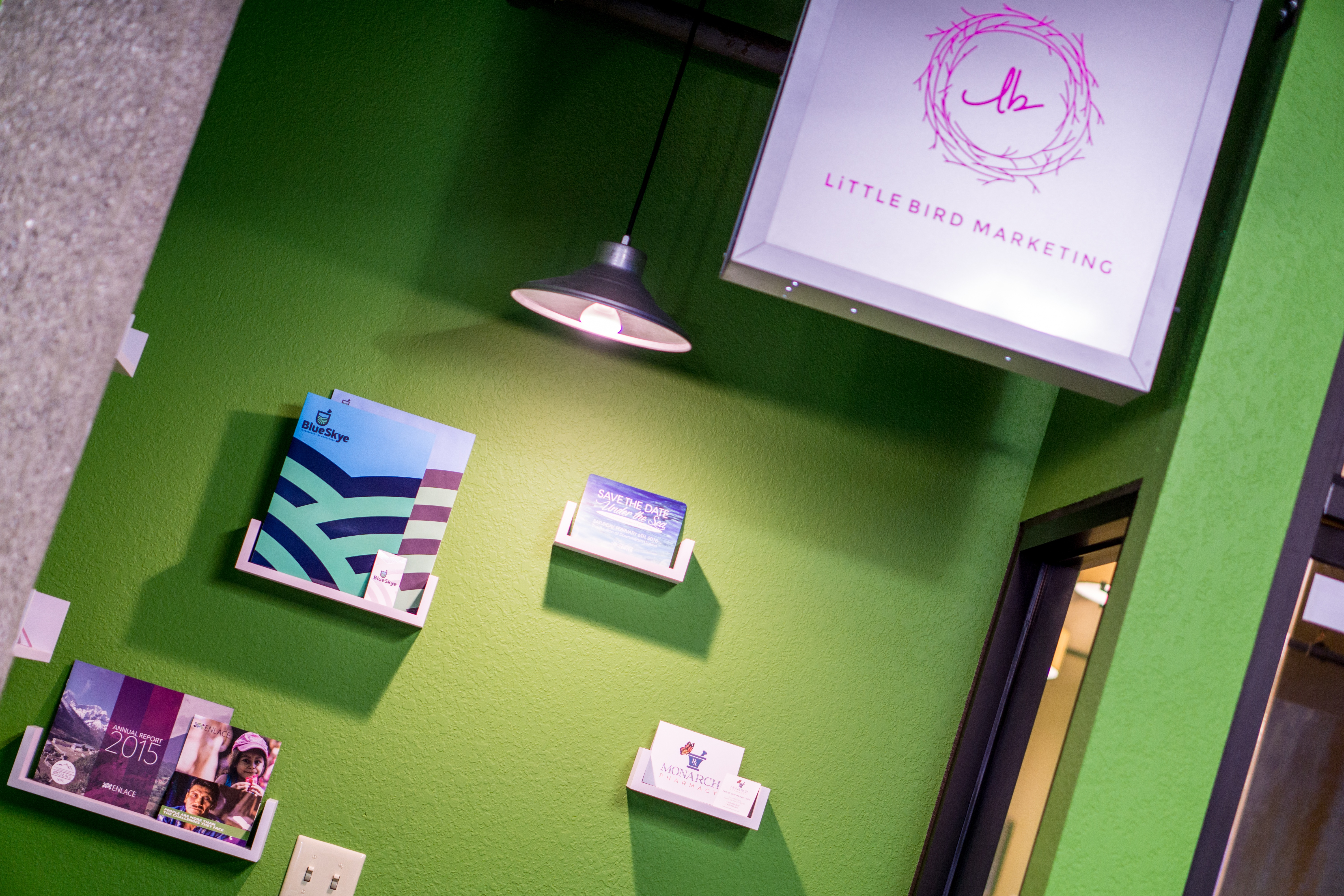 Little Bird Marketing front window display showcases a selection of our award-winning designs!